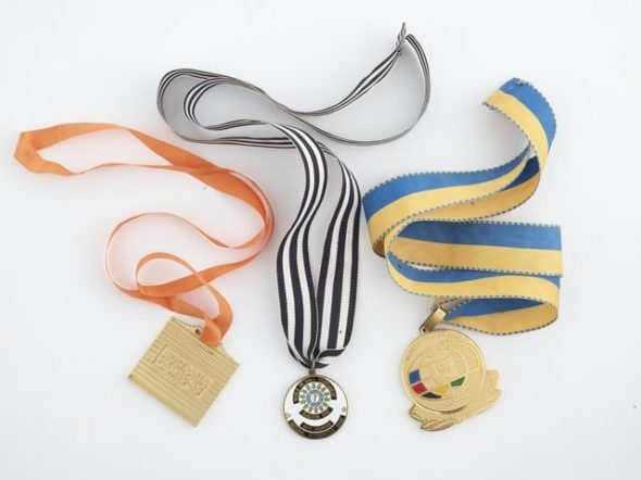 Three medals acquired by Margharet Matenga for participating in various netball tournaments as a member of the Silver Ferns.GH005349-51