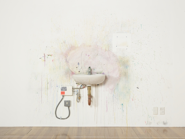 Installation photograph showing installation of artwork, Can do Academy #3, featuring a utility sink and paint spattered wall.