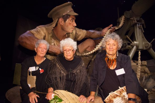The daughters of Rikihana Carkeek, with the giant sculpture of Private Rikihana Carkeek in the background. Photographed by Norm Heke, April 2015. Copyright, Te Papa, 2015.
