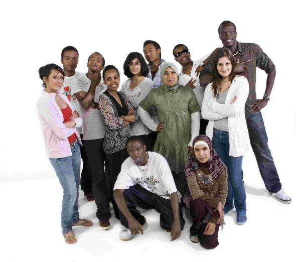 Group of refugee background youth posing for the camera.