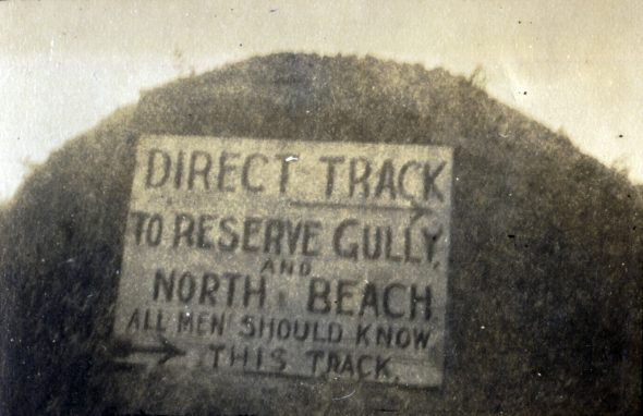 A painted notice to assist the evacuation of Anzac Cove, December 1915. Photograph by Norman Henry Prior. Wairarapa Archives (11-72/4-2-23.digital)