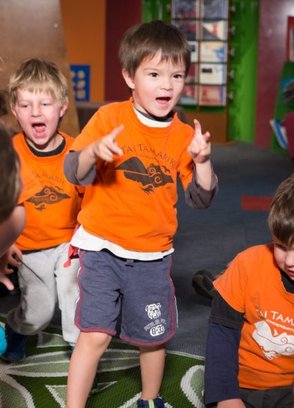Dancing like a T. rex on the spot. Photograph by Kate Whitley. Te Papa