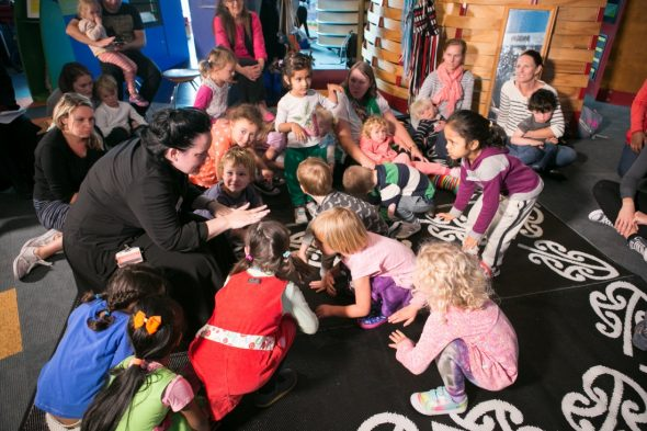 Our group of magical tigers get down low, ready to start the dance in unison with a rere (leap) and a roar, as decided by the children. Photograph by Kate Whitley. Te Papa