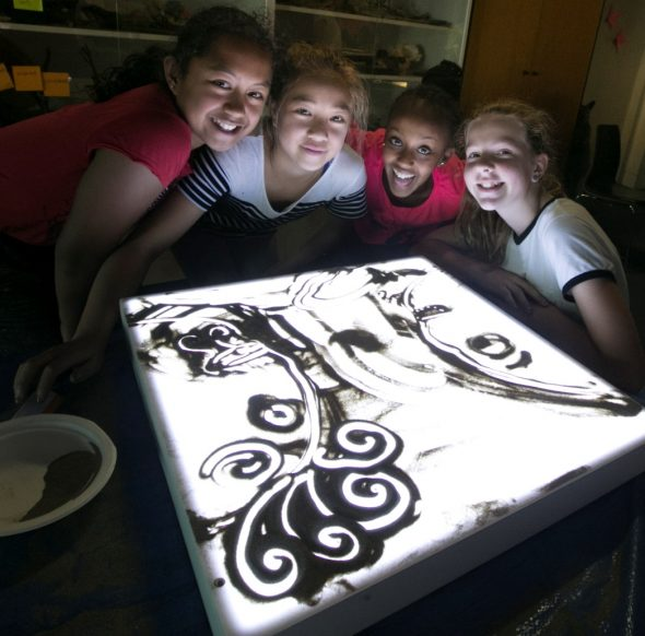 Students posing with their sand art. Photograph by Norm Heke. Te Papa