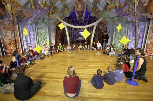 Children create a performance area with the Travelling Tuataras, 2001. Photograph by Michael Hall. Te Papa