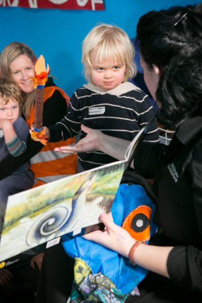 Admiring the ailao afi (fire stick). Photograph by Kate Whitley. Te Papa