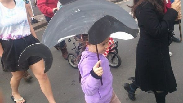 Teina Davidson on a march to save the Māuis dolphin in 2014