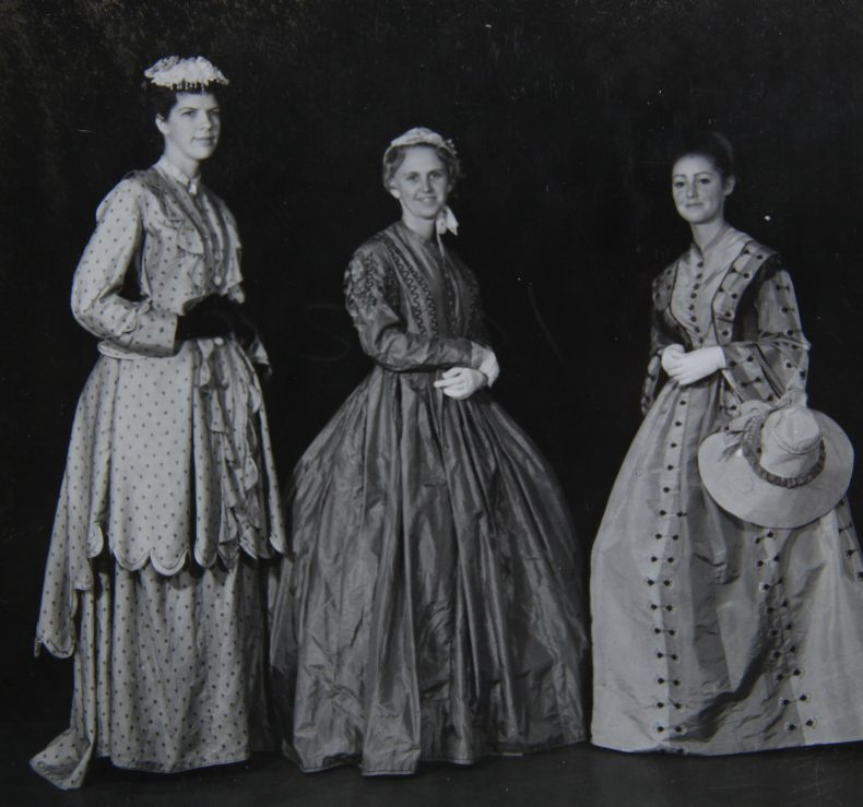B. Richardson, R. Matthews and J. Whittaker wearing items of dress from Te Papa's History collection, 28 April 1963. Digitised image of photograph by P. Hedgeland. Copyright Te Papa.