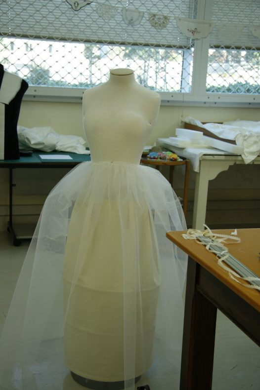 The torso after it has been padded into the correct size and period shape. There is a cotton tube underskirt to hold out the multiple layers of net underskirts instead of legs! Photo by S. Gatley, copyright Te Papa.