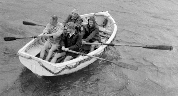 The ill-fated dinghy shortly before it capsized in Glory Bay on 26 January 1954. John Yaldwyn is closest to the camera, with Jock Moreland alongside and George Knox and Dick Dell (furthest from camera) behind. Image: Betty Batham, courtesy of Eliott Dawson.