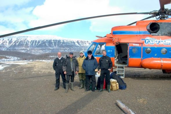 Sergey Golubev (second from left) and comrades alongside their Mil Mi-8 helicopter, Putorana Plateau, North-Central Siberia. Image: Sergey Golubev