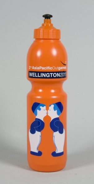 Orange drink bottle featuring image of two Dutch male figures kissing.