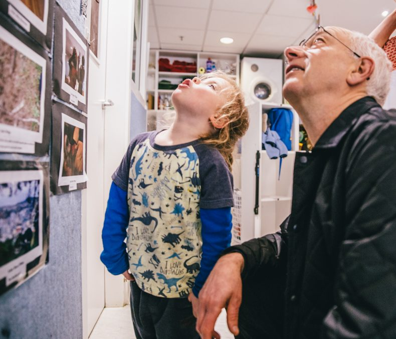 River and Athol sharing in their love of photography, Photograph by Laura Jones, © Te Papa