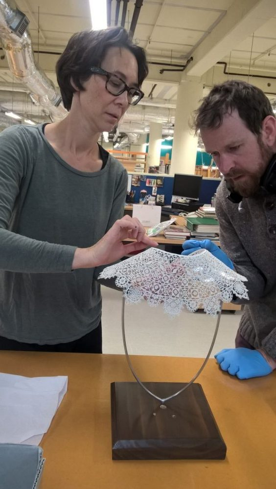 Rachael Collinge attaches the lace to the acrylic form. Photograph by Justine Olsen.