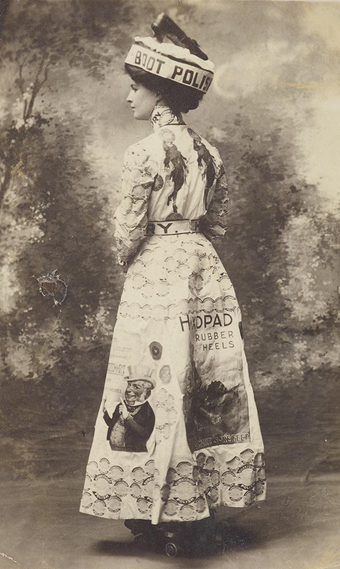 Woman wears a costume advertising boot polish