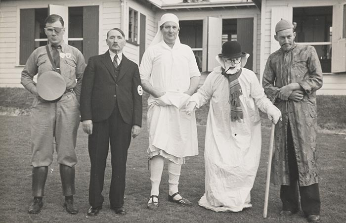 Five men in fancy dress