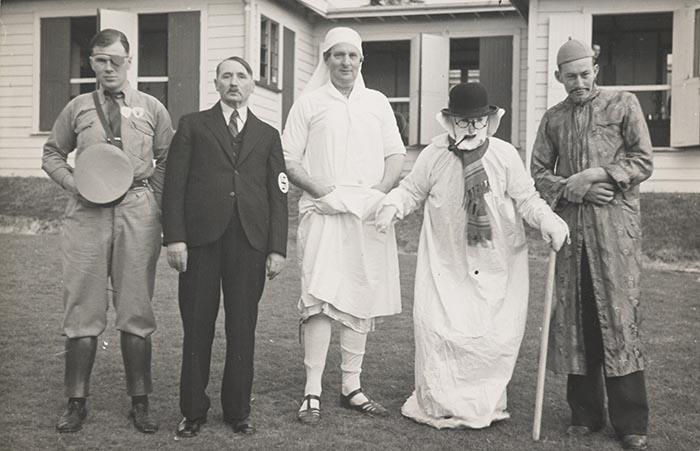 Five men in fancy dress