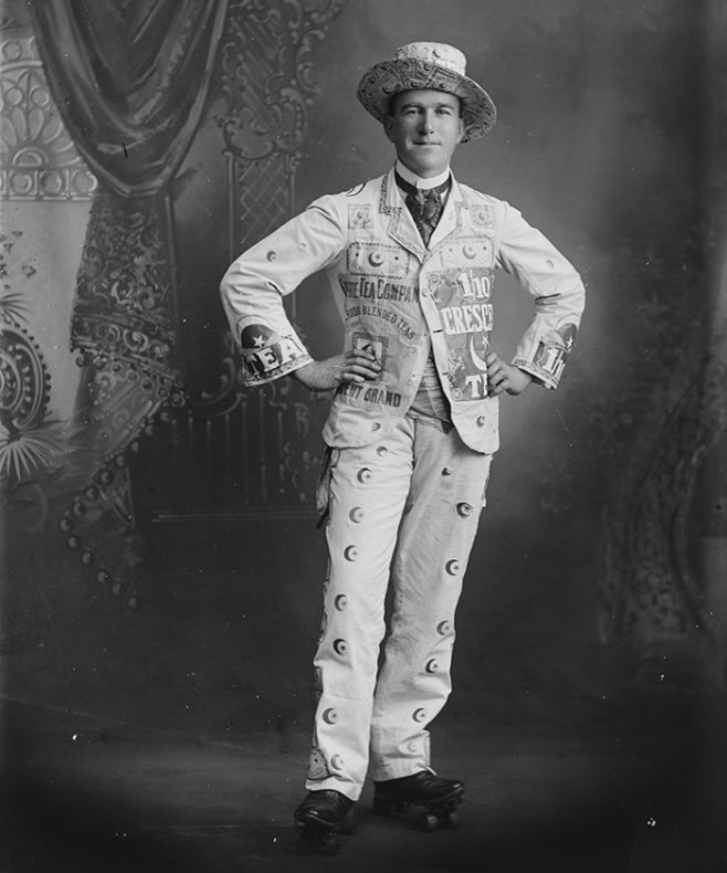A man poses in a a costume advertising tea