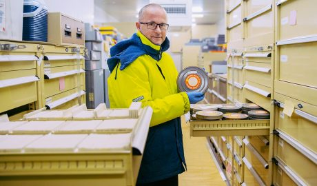 David Riley with the film reels in the cold room