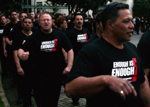 Destiny Church protestors at the Enough is Enough march wearing the t-shirt acquired by Te Papa. Image copyright: Fionnaigh McKenzie.