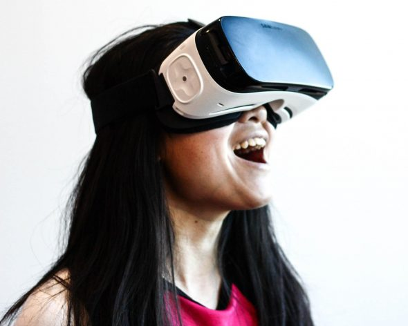 A lady wearing a VR headset
