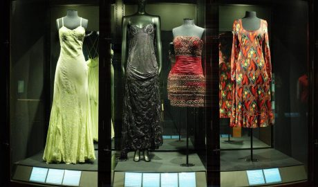 The sheer Versace day dress at far right (GH013642), on display in April 2001 alongside three other Versace dresses in Te Papa's collection.