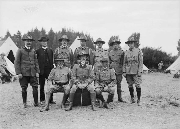 Boy Scout leaders and a clergyman, circa 1910. David Cossgrove is the centre, front, 1/2-041264-G. Alexander Turnbull Library, Wellington.