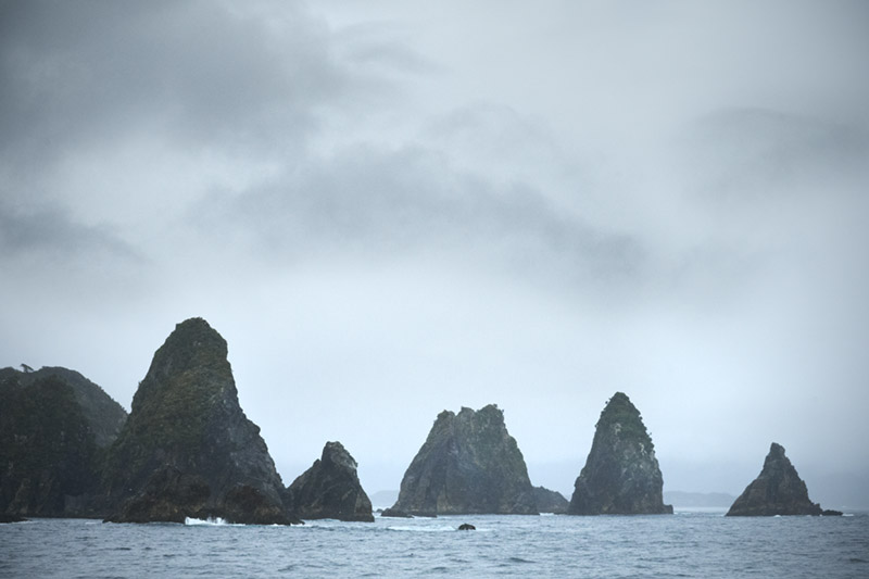 Passing the Five Fingers at the northern entrance of Dusky Sound. Image: Jean-Claude Stahl, Te Papa.
