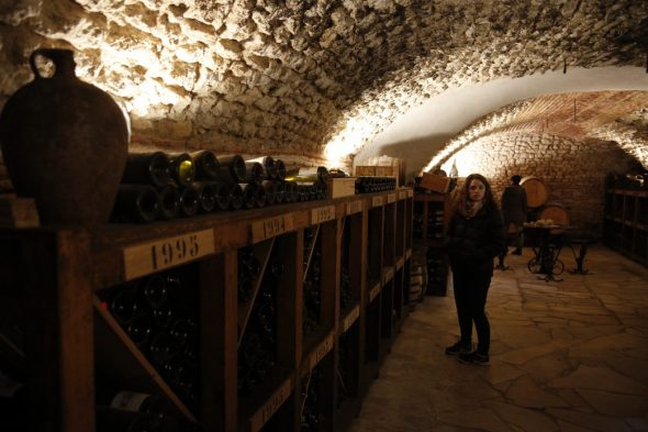 The old 'cave' in which the original Bourgeois family wine was stored, is now home to a collection of wines dating back to the 1930s, and several dozen oak barrels. Photo taken by and courtesy of Dominique Filippi.