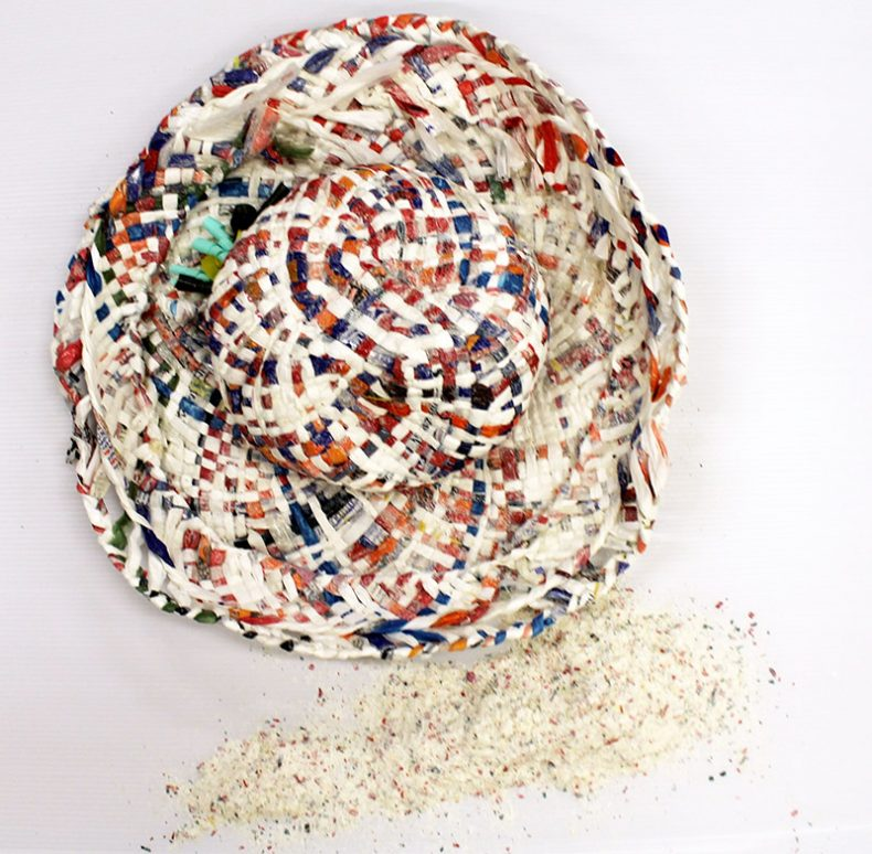 A degrading plastic hat made out of woven plastic bags