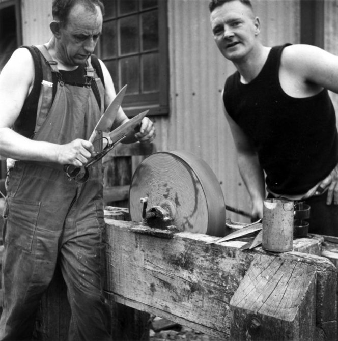 Sharpening shearers' blades, Grasmere Station, near Cass, Canterbury. Pascoe, John Dobree, 1908-1972 :Photographic albums, prints and negatives. Ref: 1/4-000882-F. Alexander Turnbull Library, Wellington, New Zealand. http://natlib.govt.nz/records/23153802
