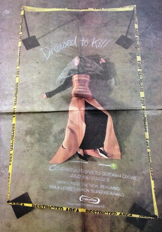 A poster for the Smokefree Fashion Awards featuring a woman lying on the ground in the winning dress, surrounded by police tape to resemble a crime scene