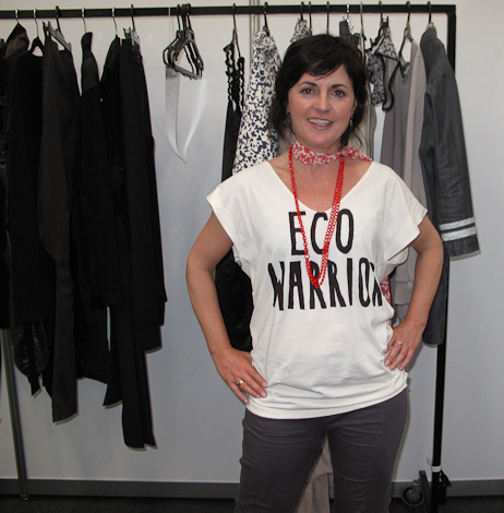 Laurie Foon pictured in front of a rack of clothing