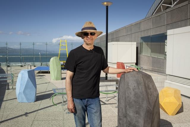 Paul Cullen stands beside his artwork A Garden