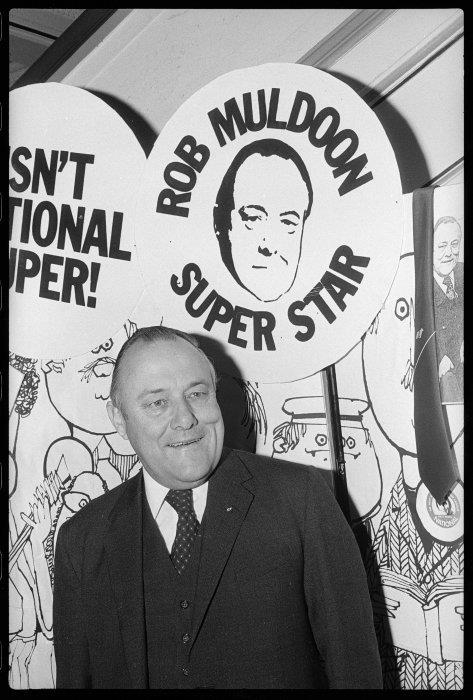 National Party leader Rob Muldoon at party conference. Dominion post (Newspaper) :Photographic negatives and prints of the Evening Post and Dominion newspapers. Ref: EP/1975/3056/5-F. Alexander Turnbull Library, Wellington, New Zealand. http://natlib.govt.nz/records/22898560