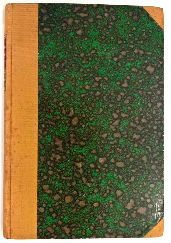 Green blotted marble cover on a yellow/gold leather bound book