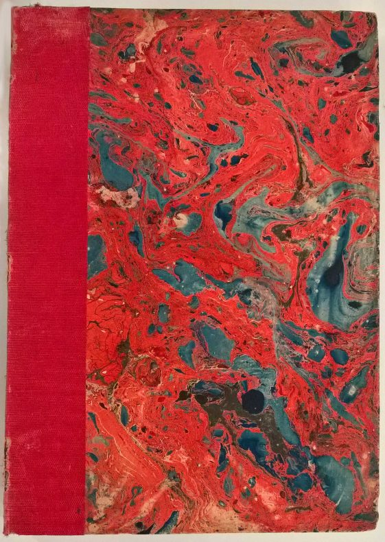 Bright red marble covered book