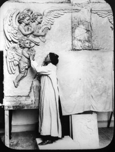S. Rosamond Praeger working on the decoration of the  façade of the Thomas Andrews/Titanic Memorial Hall. Photo courtesy of Joseph McBrinn.