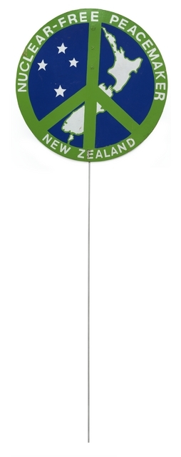 CND symbol over map of New Zealand as a lollipop shaped placard on a stick