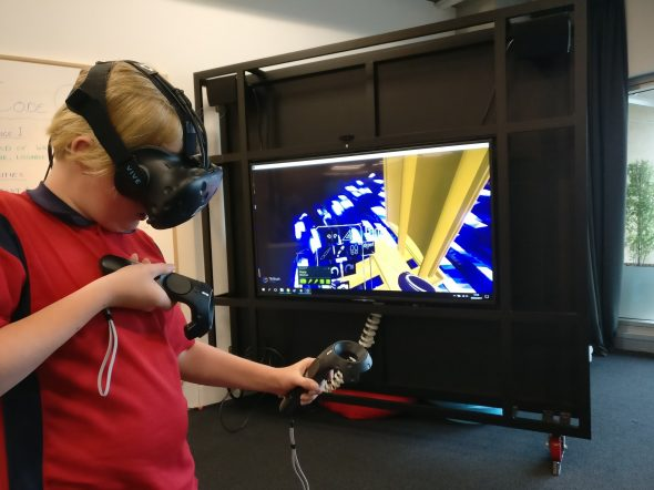 A learner interacts with their own 3D designed Vaka (ocean canoe) prototype in VR, 2017. Te Papa