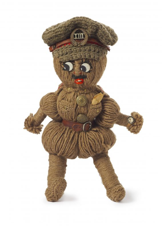 A doll of a soldier made of wool