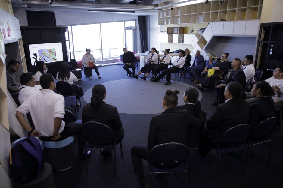 Students sit in a circle during a workshop