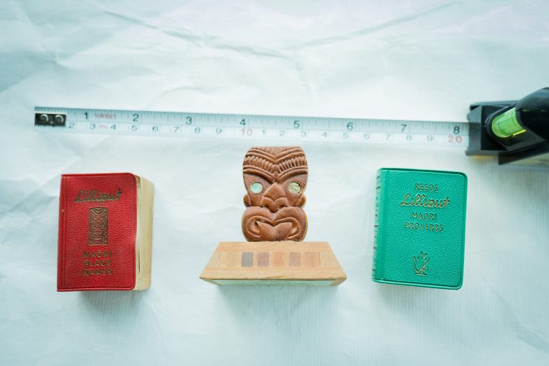 2 tiny books with a minature wooden stand
