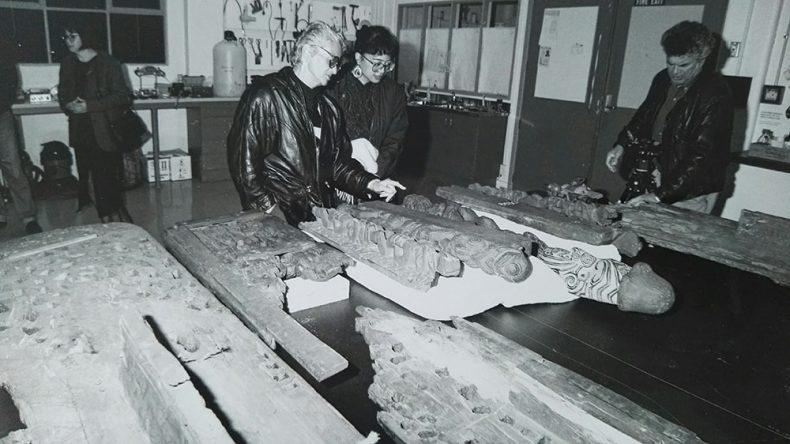 People look at carvings