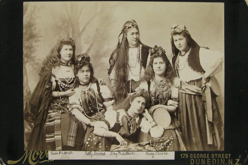 Sepia-toned photograph of women posing