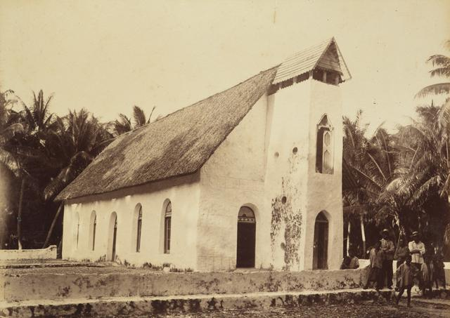Old photograph of a church with people standing in front of it