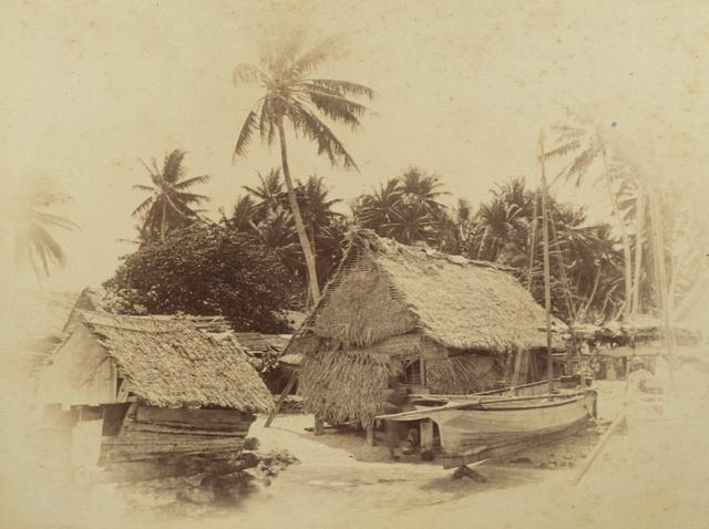Old photograph of huts on a Pacific Island