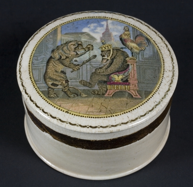 Jar with painting on its lid depicting a bear in manacles
