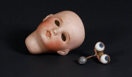 A dolls head, the eyes lie beside the head