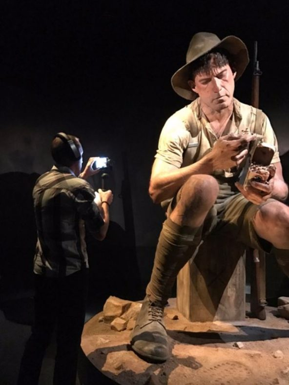 A man films one of the giant models in the Gallipoli exhibition
